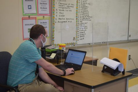 Mr. Frazzini assigning work for his students.