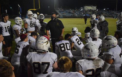 Coach Hampton motivates players during halftime of the St. James game.