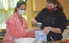 Mrs. Gorcesky measures out flour with Sydney Alderman.