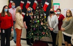 Guidance Department Members surround the Angel Tree, which students raised money for.