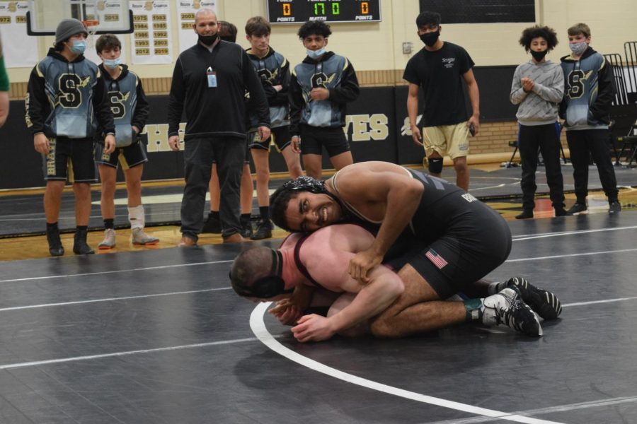 Eessa Abdulmutaale uses his strength to remain on top of an opponent from Carolina Forest until time runs out.