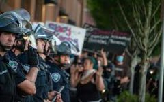 Police officers stand guard to make sure protester's do not disturb the community.