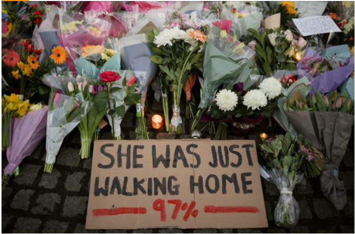 A+sign+and+flowers+placed+at+a+memorial+site+for+Sara+Everard%2C+who+was+kidnapped+and+killed+in+the+UK+in+March.