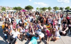 Izzy Zygmont stands with participants in the Pride Festival at The Market Common.