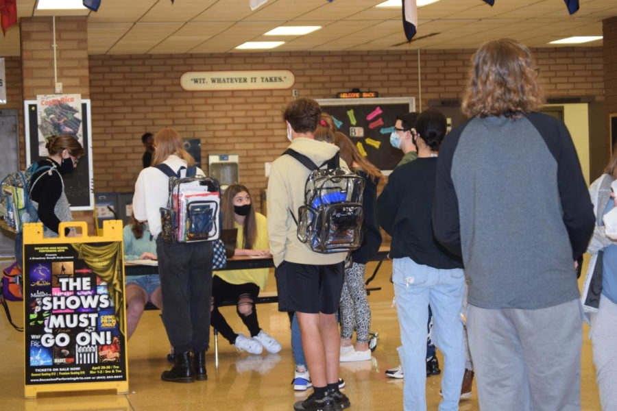 Students wait together to purchase tickets for the student showing of the musical.