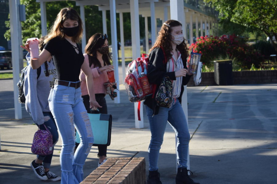Junior Edisto French walks into school with a group of friends on the first day