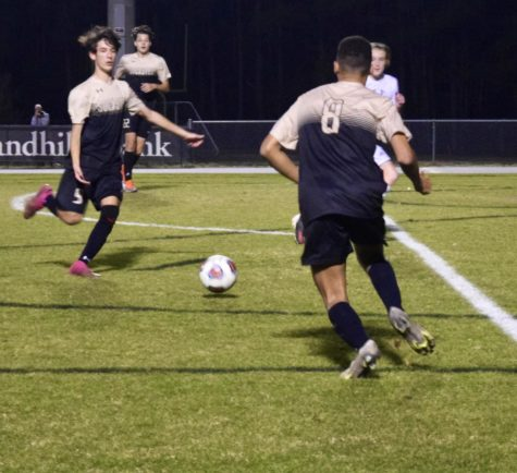 Carter Chapelle attacks the ball during a boys soccer game.
