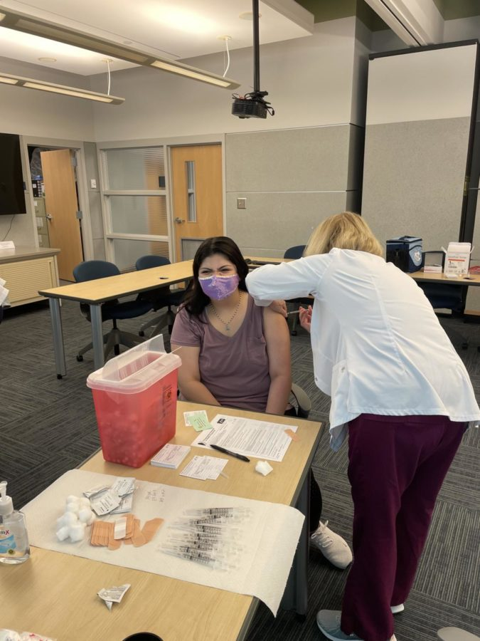 Sophomore Alexis Harris receives her first dose of the vaccine