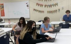 Freshmen Abby Keough and Emma Conrad sit in Yearbook class without masks, having   turned in a form that allows them to opt out of doing so.