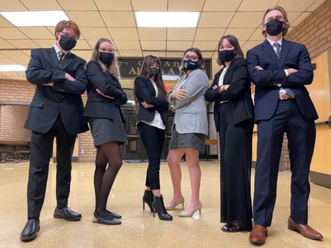 The Mock Trial Team stands ready to compete in attorney attire.