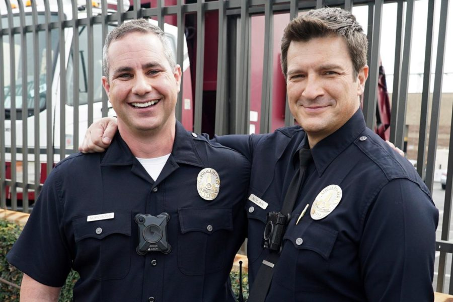 Nathan Fillion with William Norcross, the real-life cop who inspired The Rookie.