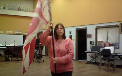 Mrs. Polenick demonstrates a color guard routine.
