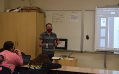 Mr. Mol shares a presentation with his English students.