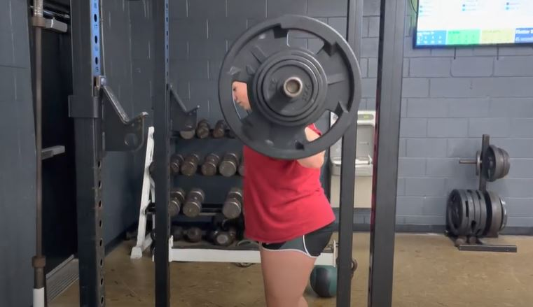 Junior Hailey Rappeno squats during weightlifting class.