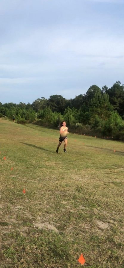 Hayden Marks runs in a cross country race against Carolina Forest.