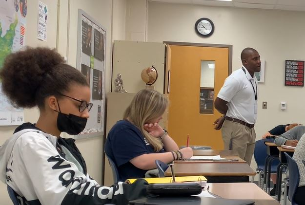 Mr. Helton gives a lecture during his 1st block sociology class.